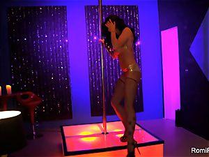 Romi Rain gets wild on the stripper pillar
