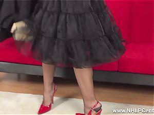 big-boobed brunette milks in sheer RHT nylons red high-heeled shoes