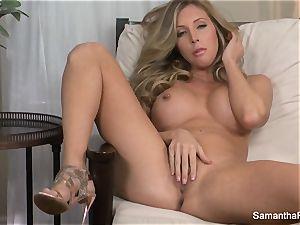 busty blond Samantha Saint fingers her vagina