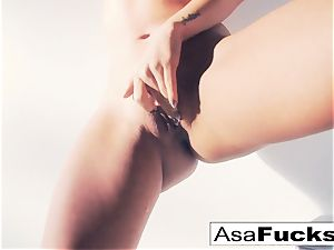 Asa Akira uses a faux arm to sate her cunt